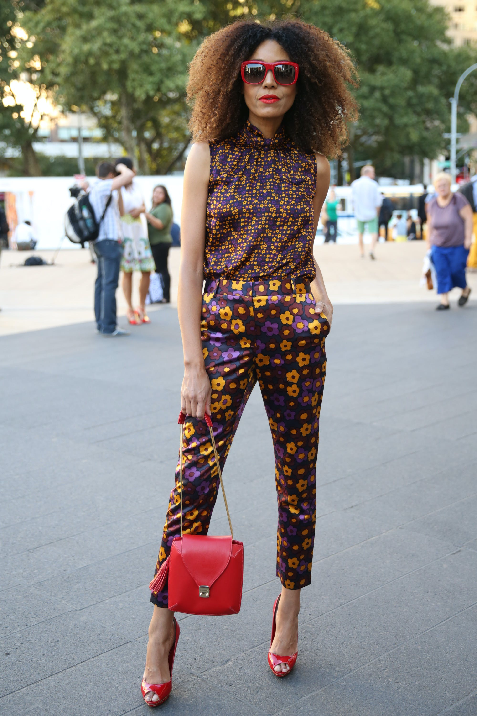 woman wearing a min print top and large print pants