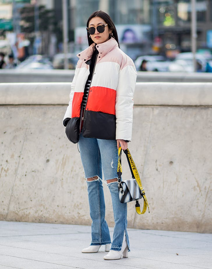 woman wearing jeans a with a slit hem