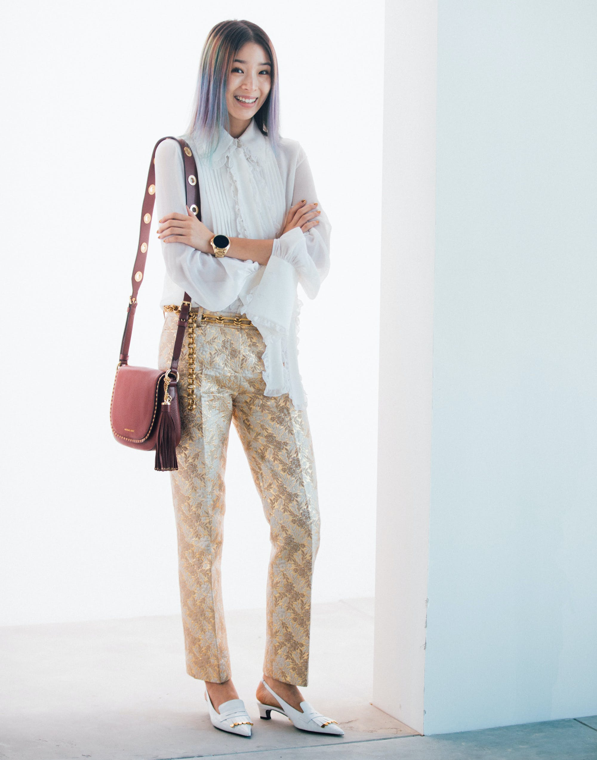 woman wearing snakeskin pants