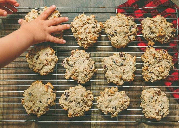 Kid grabbing cookies