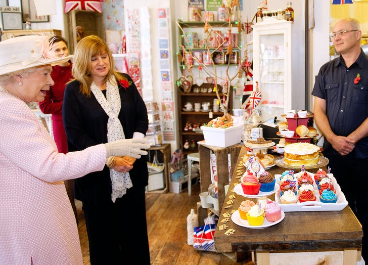 Queen Elizabeth reaches for cake