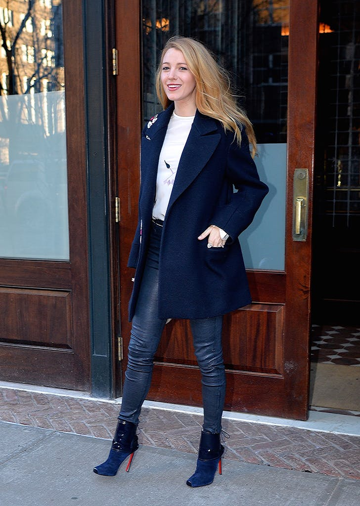 blake lively wearing leather leggings and a navy jacket