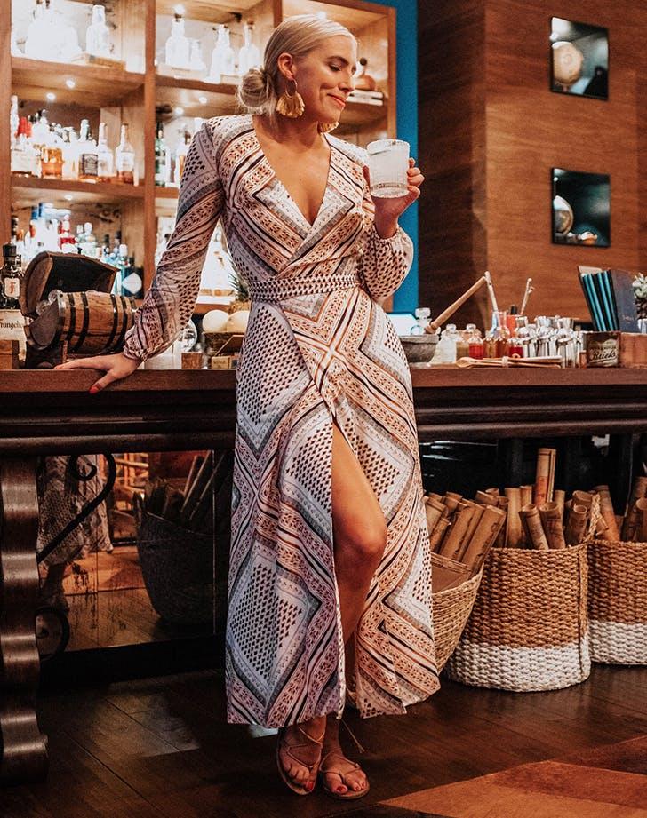 caroline juen wearing a pretty wrap dress