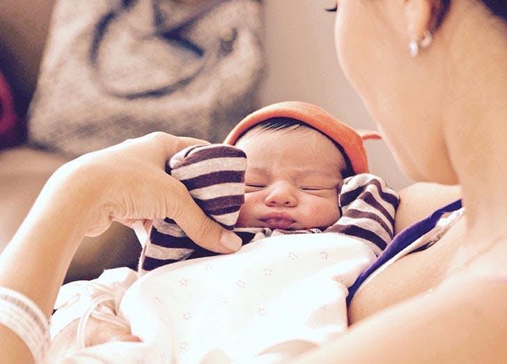 mom holding newborn baby