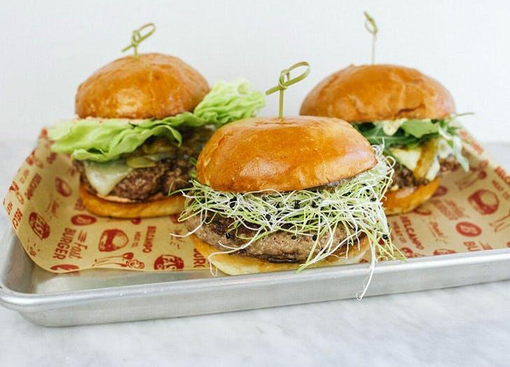 three burgers on tray