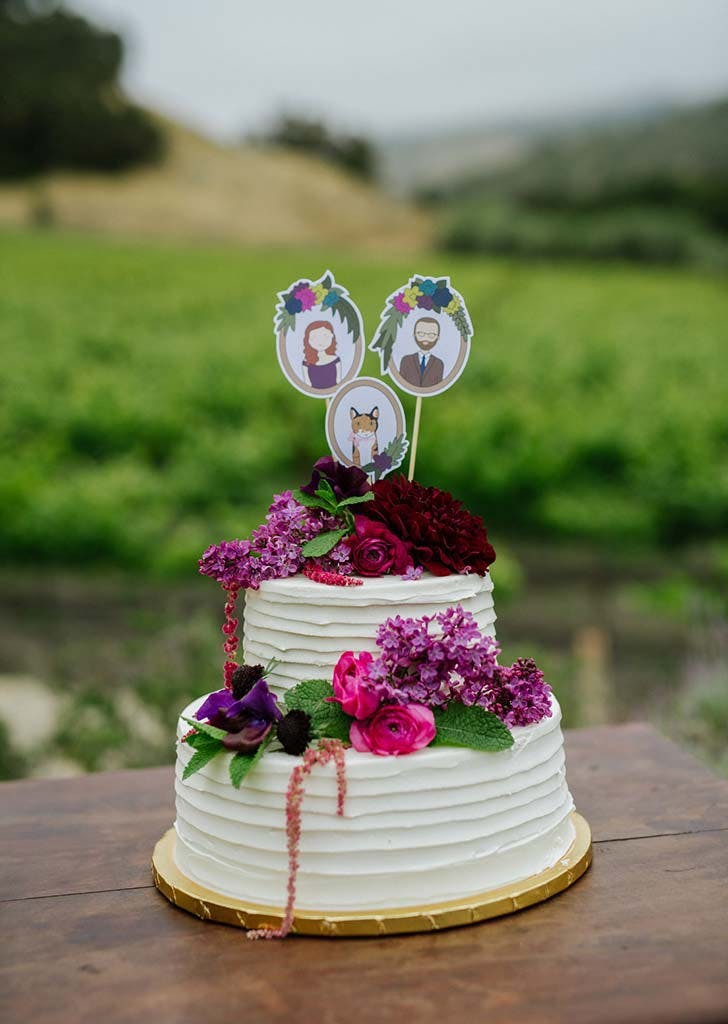 white wedding cake with flowers and drawings