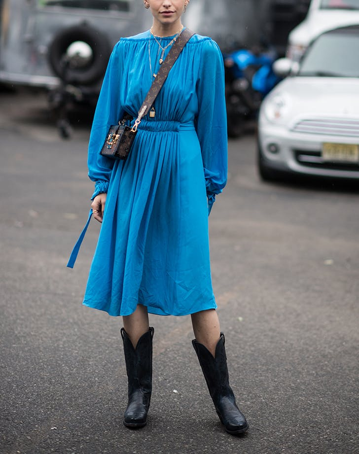 woman wearing a dress and cowboy boots