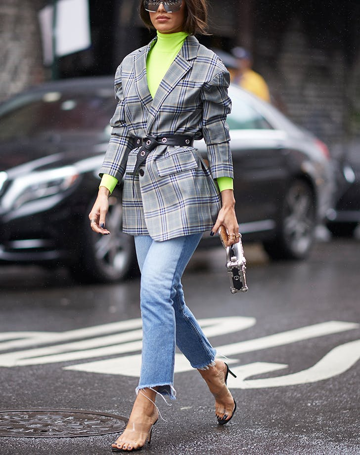 woman wearing a neon turtleneck and plaid blazer