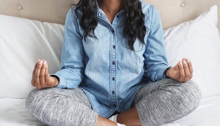 woman meditating to destress