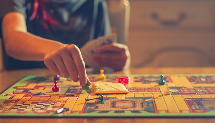 woman playing board games to destress