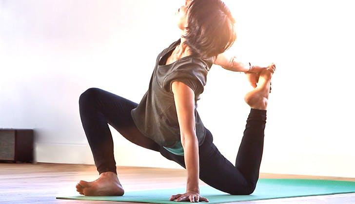 woman practicing yoga to destress