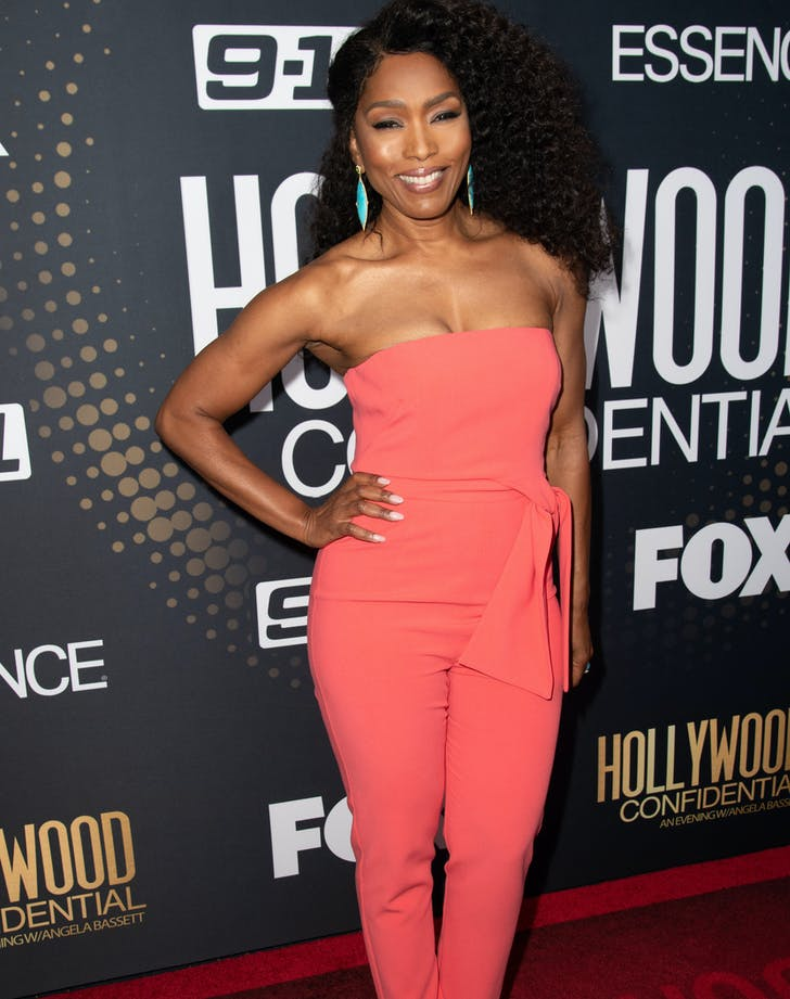 Angela Bassett in coral jumpsuit.c1