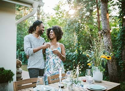 Couple hosting dinner party 400
