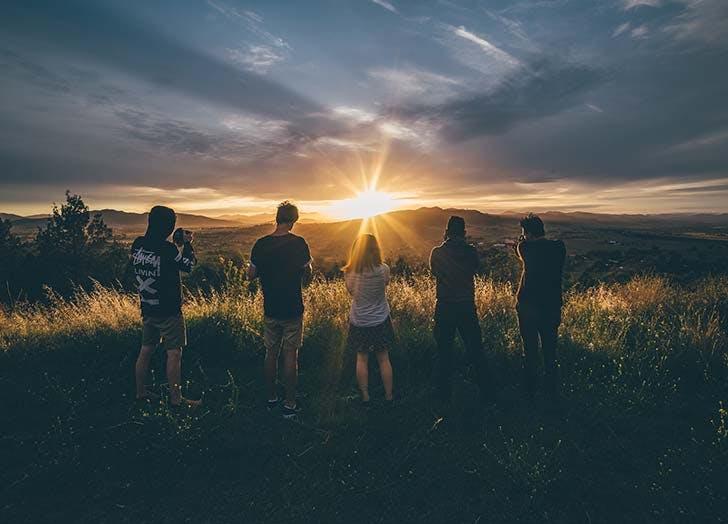 Friends watching sunrise