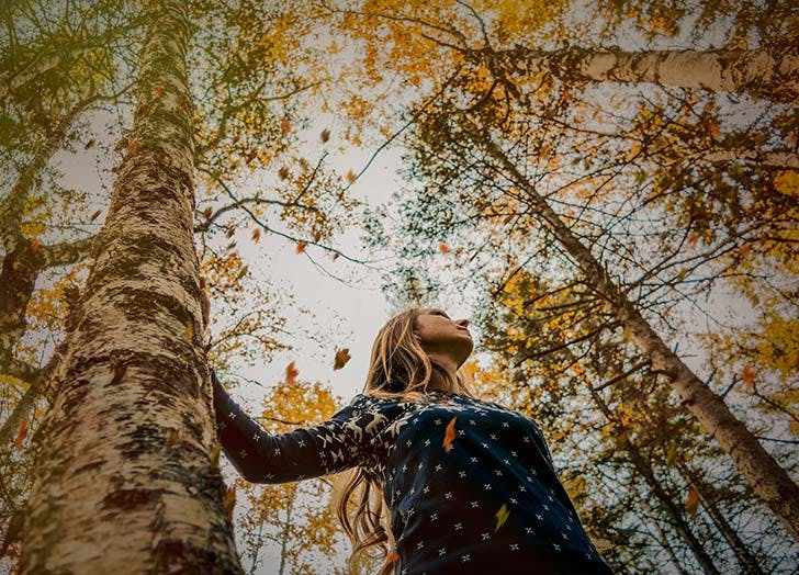 Girl outside in fall forest