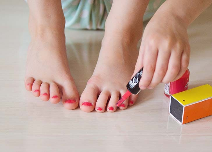 Girl painting toe nails