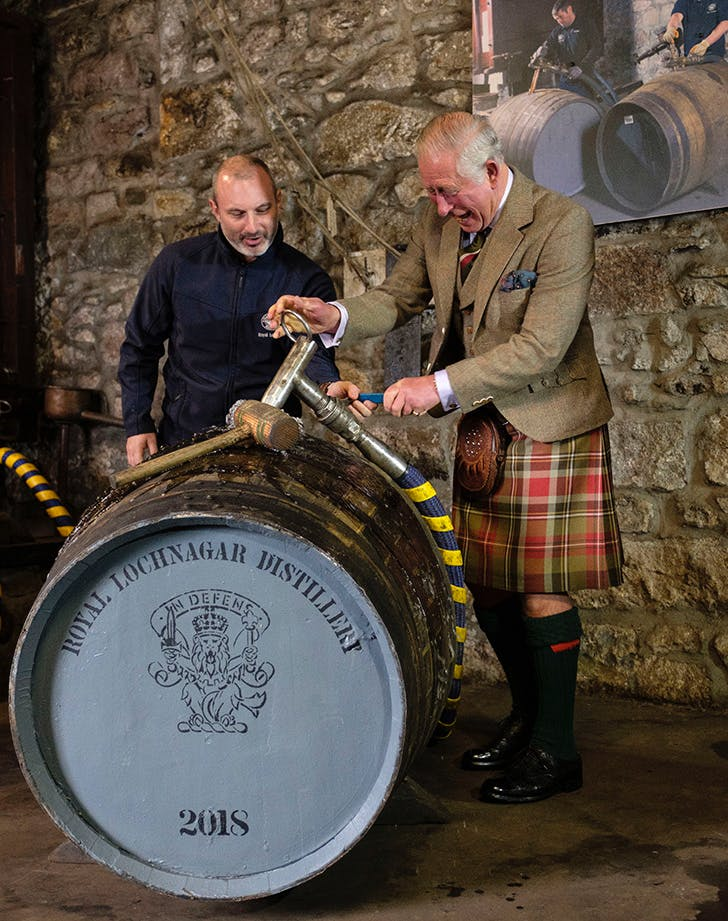 Prince Charles tapping open cask