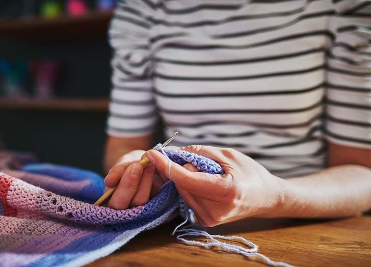 Woman knitting a scarf