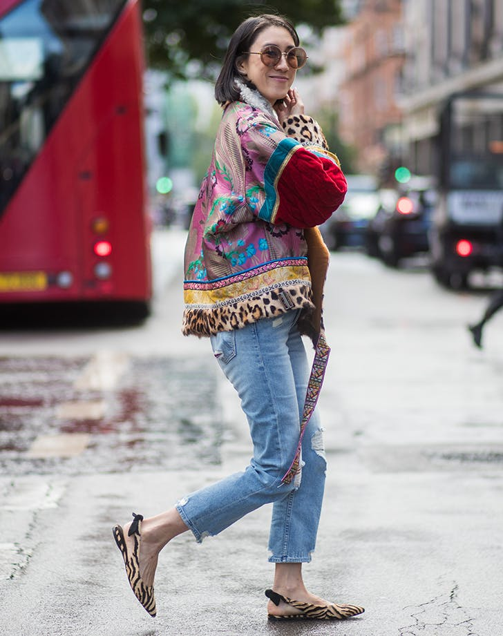 eva chen wearing a printed jacket and jeans