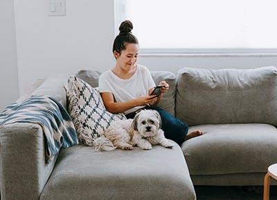 girl on couch with dog 400