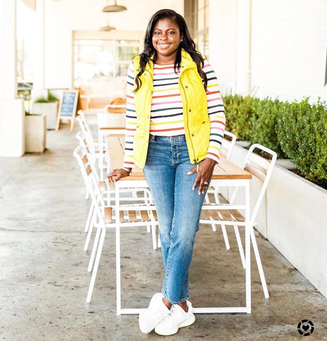 e8437b71db7 jasmine crockett wearing a yellow vest and rainbow stripe top