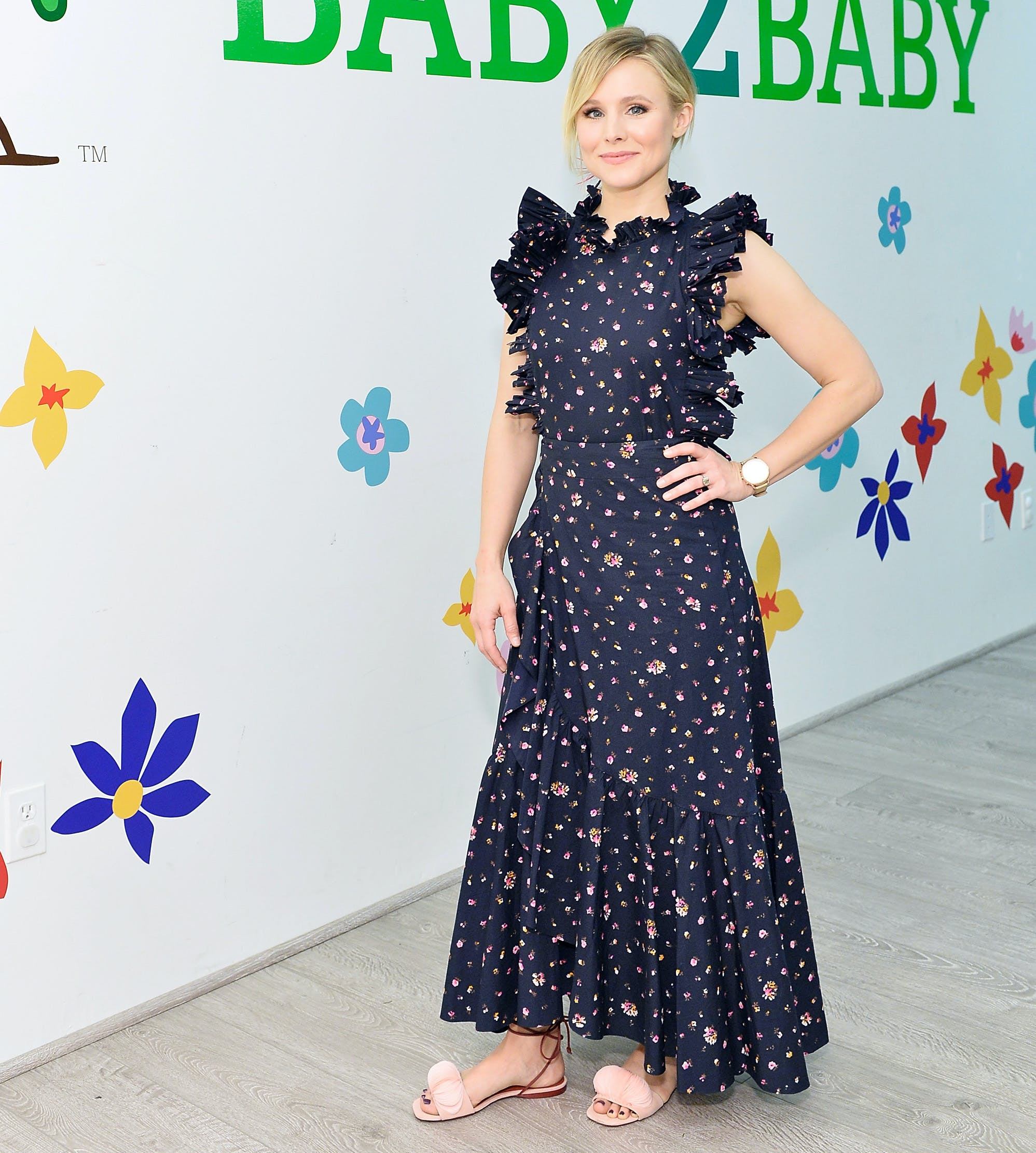 kristen bell wearing a maxi dress and sandals