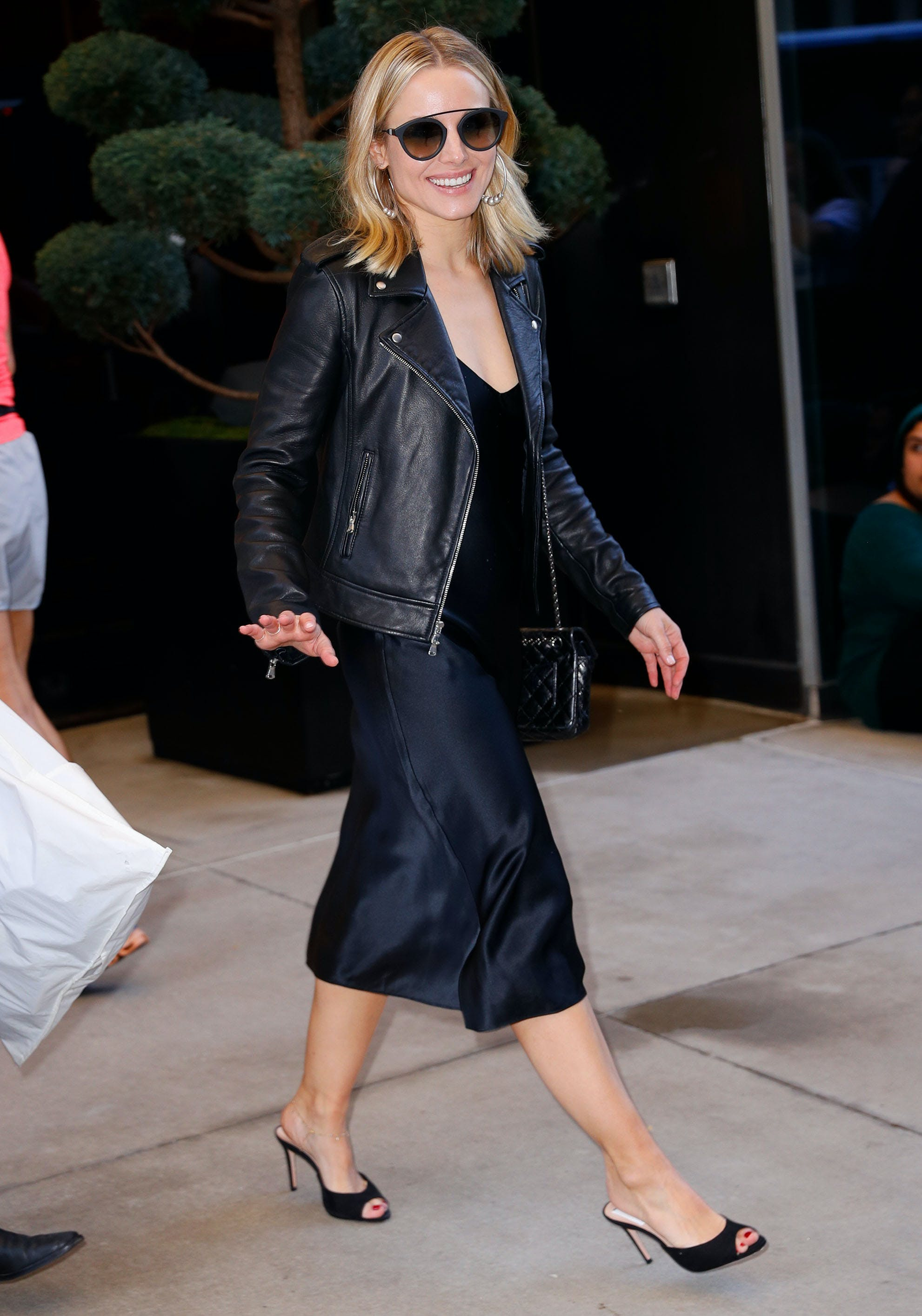 kristen bell wearing a moto jacket slip dress and mules
