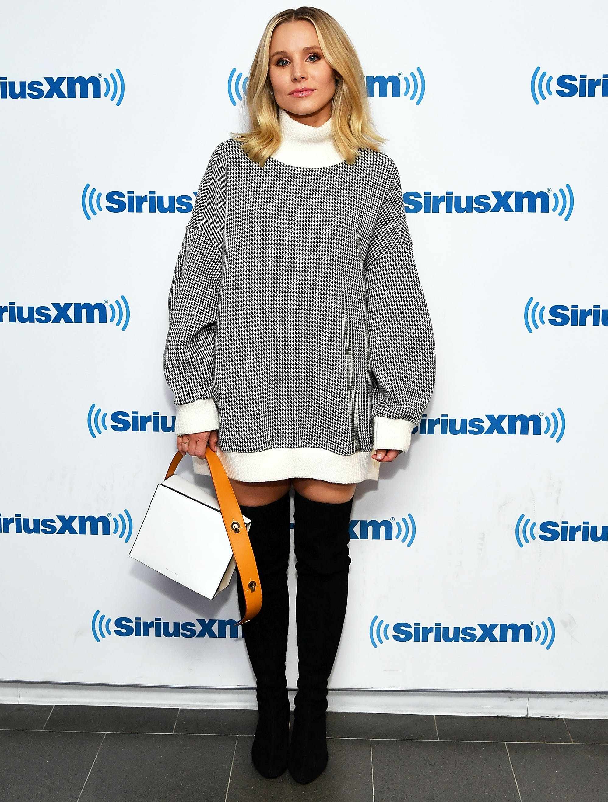 kristen bell wearing a sweater dress and otk boots