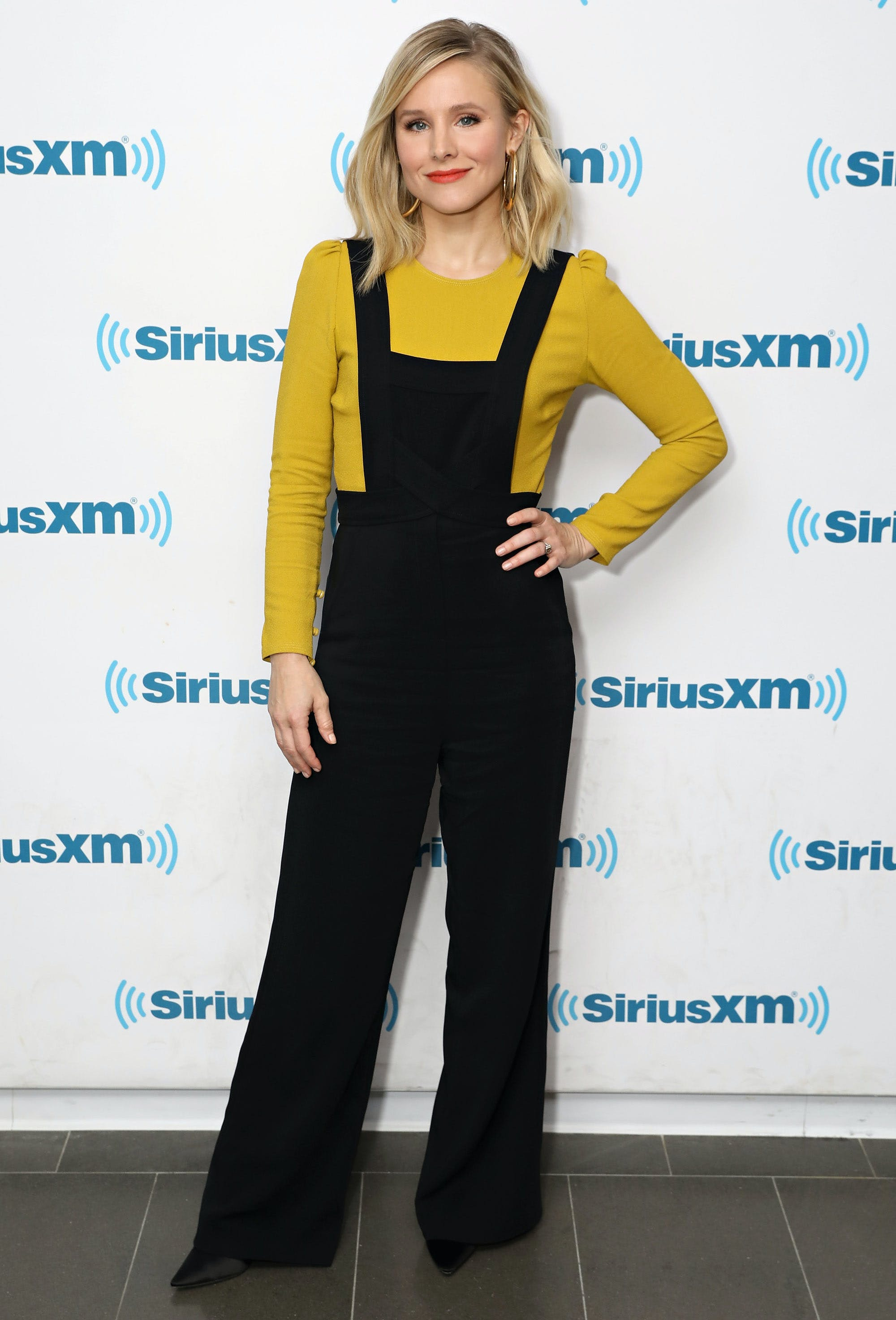kristen bell wearing overalls and a long sleeve shirt