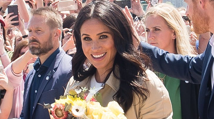 A Man Gave Meghan Markle a Huge Bouquet of Flowers & Prince Harry Candidly Responded