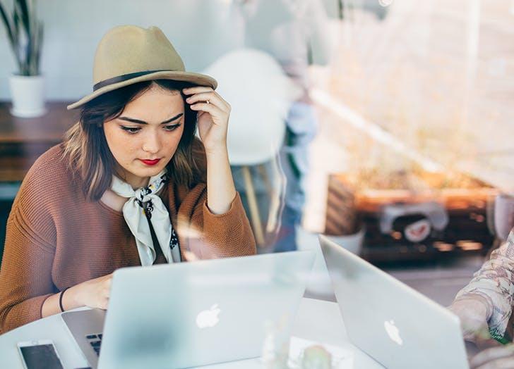 woman on laptop in coffee shop