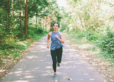 woman running outside cat