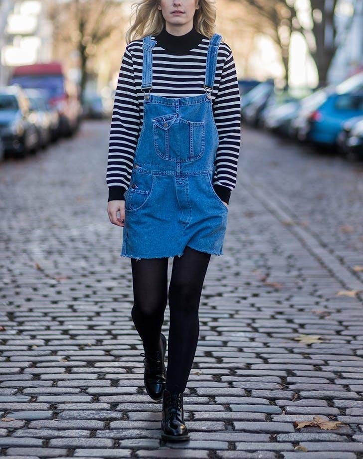 woman wearing a denim dress and striped sweater1
