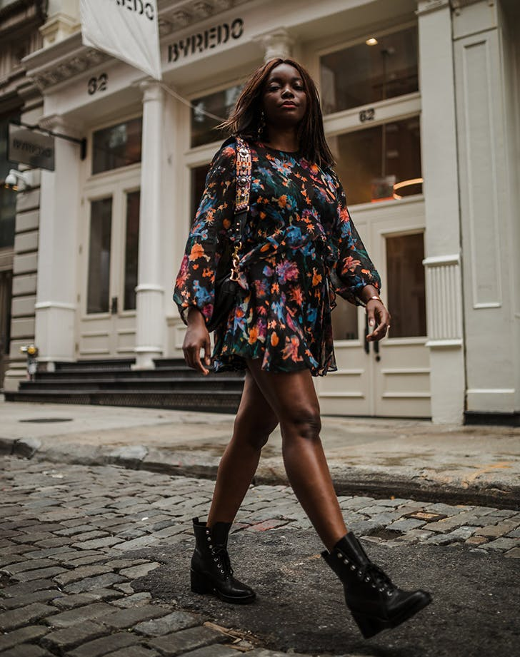 woman wearing a floral minidress and boots