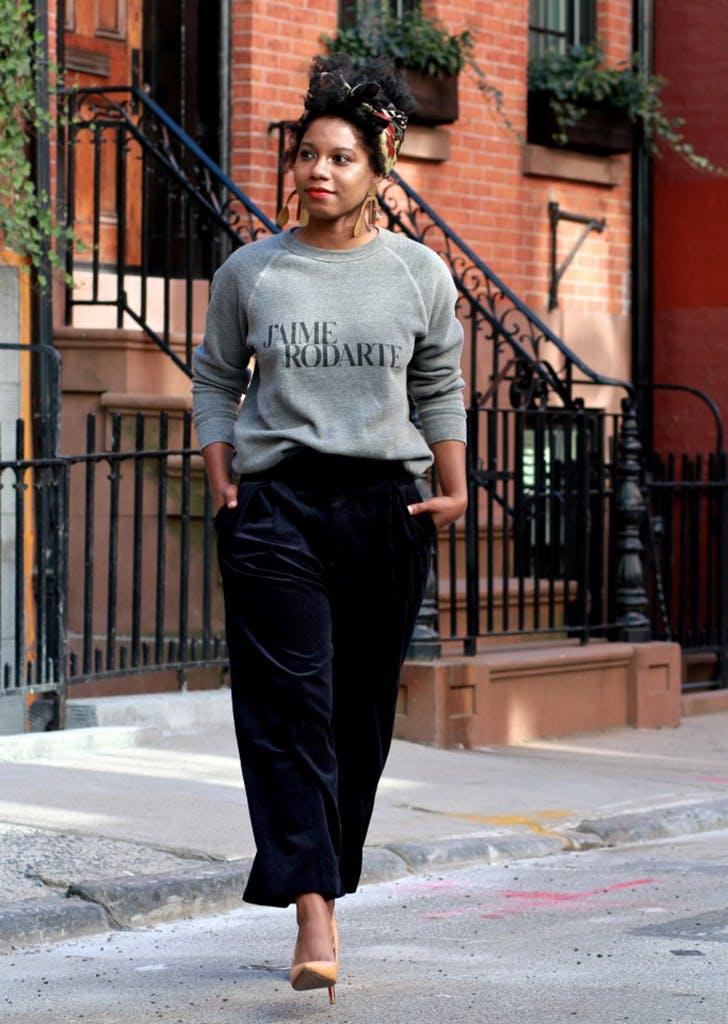 e78dd4cff8d woman wearing a gray sweatshirt and trousers
