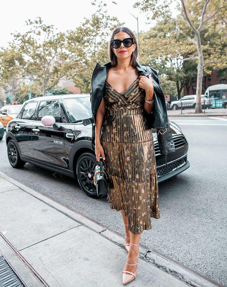 woman wearing a midi dress and moto jacket