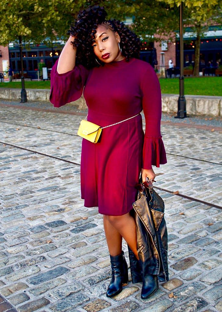 fb414e08f7d woman wearing a sweater dress and belt bag1