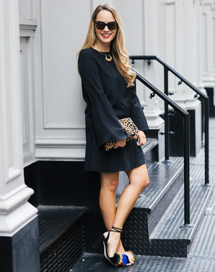 woman wearing an lbd and statement shoes