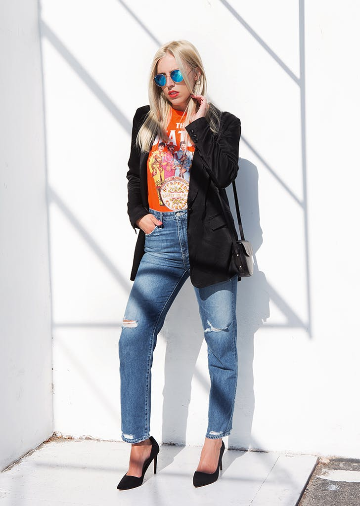 woman wearing jeans a graphic tee and blazer