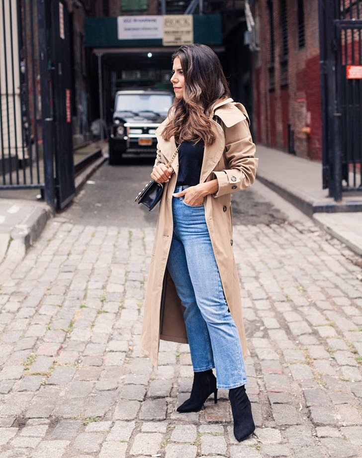 5613093a605 woman wearing jeans a sweater and trenchcoat. Olivia Jeanette