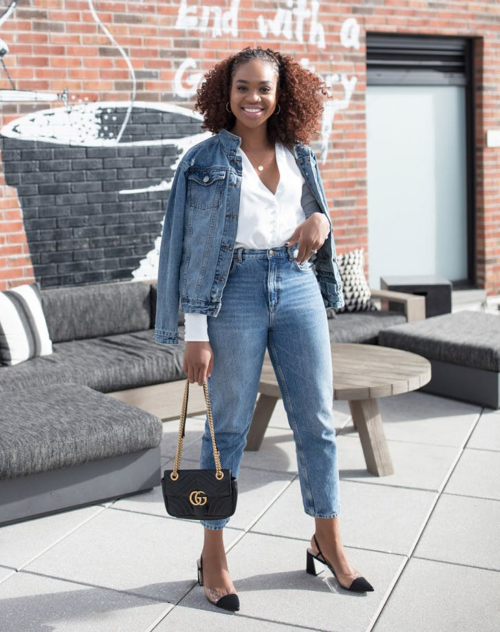 woman wearing jeans a white button down and a jean jacket