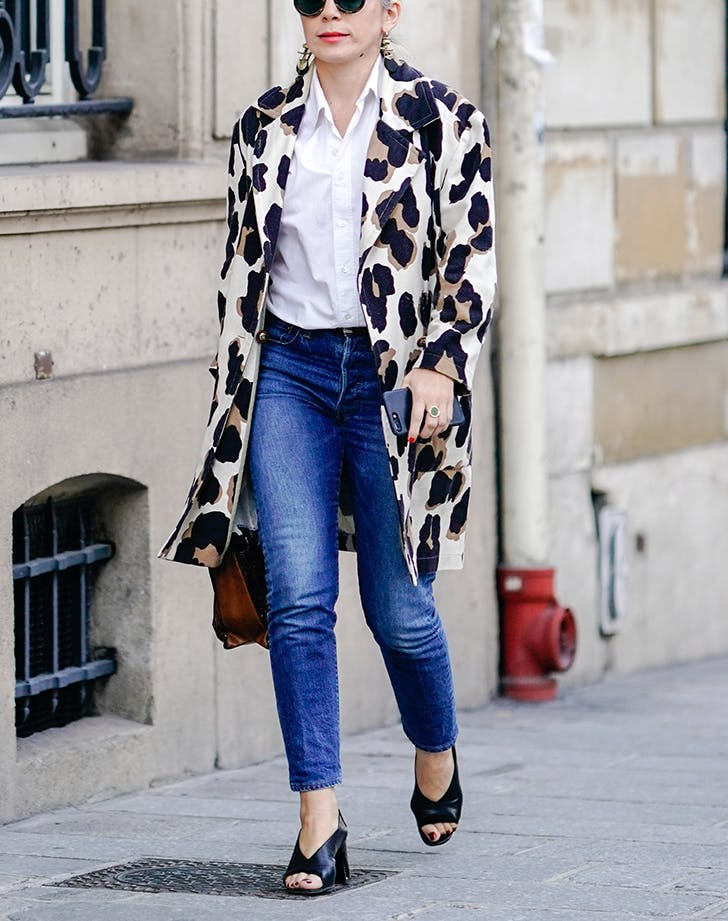 woman wearing jeans and a leopard print jacket