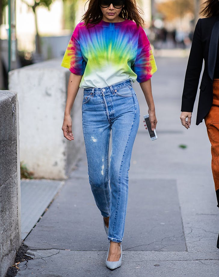 woman wearing jeans and a tie dye tshirt