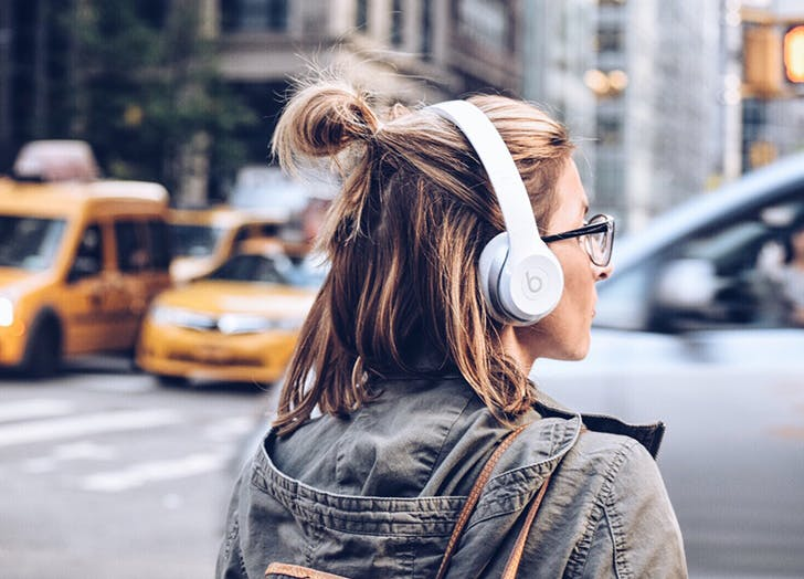 woman listening to her favorite song to manage stress