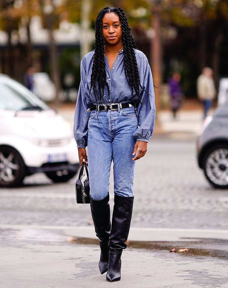 woman wearing all denim and black boots