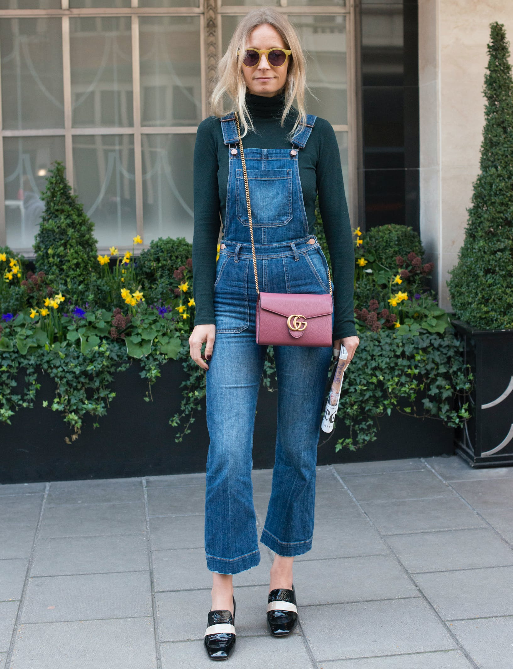 woman wearing overalls and a turtleneck
