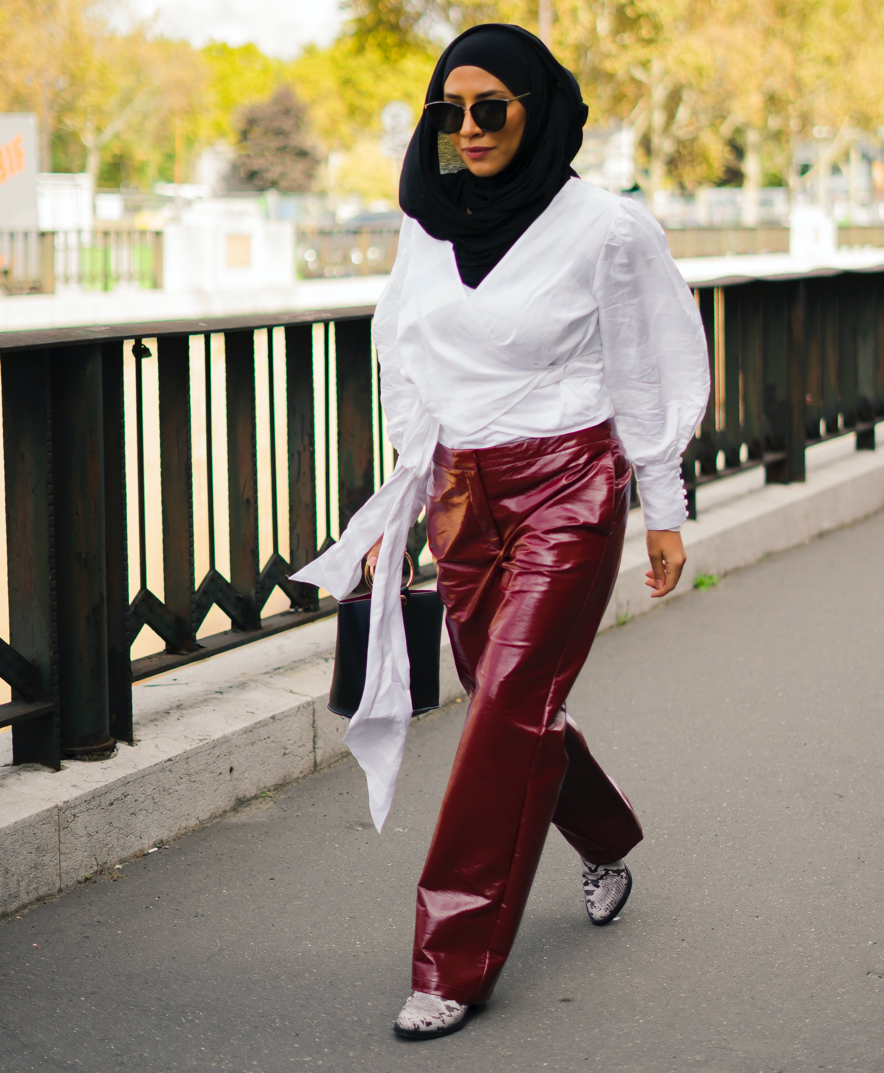 woman wearing patent leather trousers