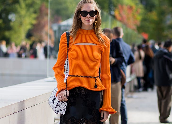 woman wearing sweater with cut out detail