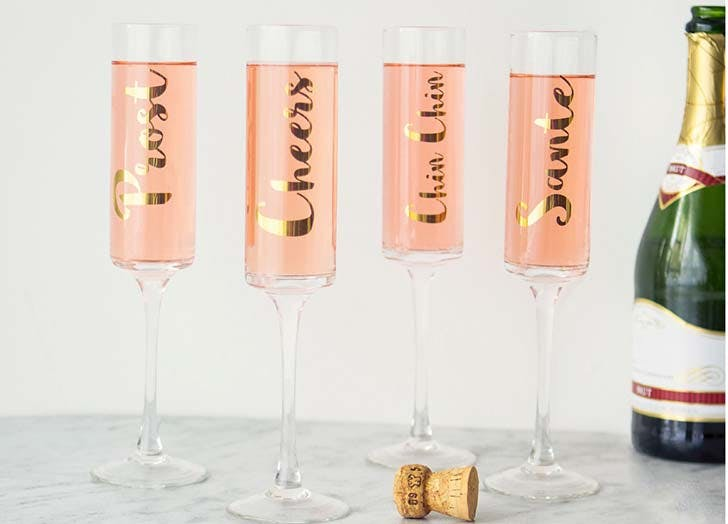 Contemporary Gold Cheers Champagne Flutes from Target