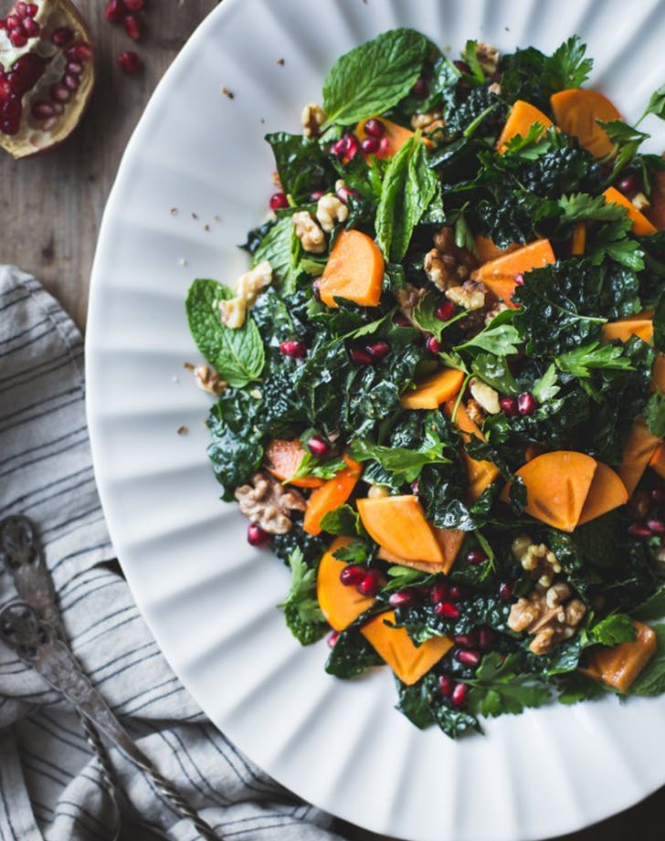 Herbed Kale Salad with Persimmon Pomegranate and Maple Cumin Dressing recipe